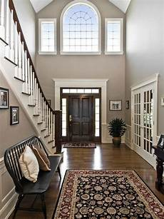 traditional entryway with high ceiling hardwood floors