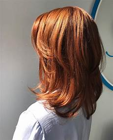 copper red straight medium length hair with chunky layers