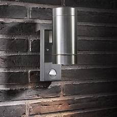 buy tin outdoor wall lighting with sensor by nordlux the worm that turned revitalising your