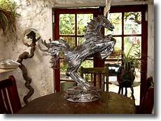 amazing metal sculptures made from reclaimed bronze recycled metal statue sculpture made from knives
