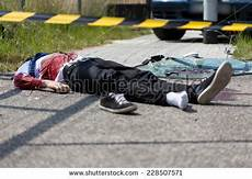 mort sur la route dead lying on road after stock photo royalty free