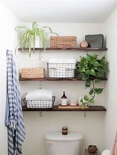 bathroom shelves decorating ideas 25 clever ways to decorate above the toilet one thing three ways hgtv