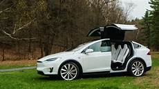 tesla model y doors how to open the tesla model x s falcon doors in an