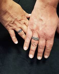 super cool engagement and wedding ring tattoo ideas for couples