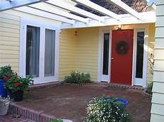 bm heritage front door glidden jonquil yellow house brick patio things to live in my