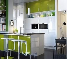 design white and green kitchen interior with quartz