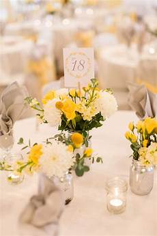 yellow and white centerpiece with mums and craspedia in 2020 yellow wedding flowers white