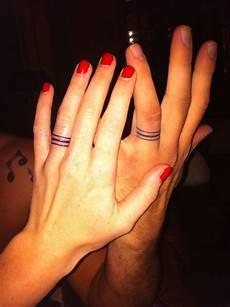 25 awesome wedding ring tattoos wedding band tattoo