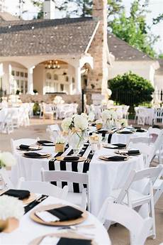black and gold wedding decorations outdoor table setting white table and chairs with black