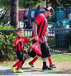 Joel Madden And Sparrow Wear Matching Uniforms As He