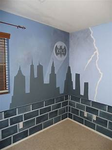 custom mural done in a room the rest of gotham city brick border is throughout the whole