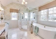 bathroom bathroom with soaking tub glass shower mini chandelier from the progress lighting