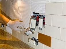 ceramic tile installation on kitchen backsplash 10 stock