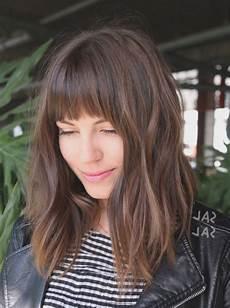 15 Hairdos With Bangs For Medium Length Hair The Frisky