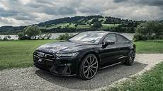 more powerful audi a7 sportback by abt poses on 22 inch wheels