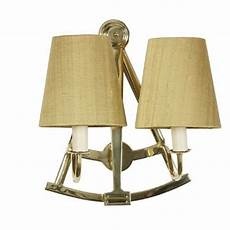 sextant naval style double wall light in solid brass with gold shades