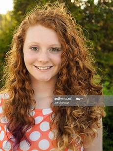 young girl with red hair stock photo image of forest portrait of smiling caucasian girl with red hair high res stock photo getty images