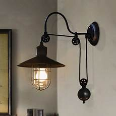 industrial farmhouse style 1 light adjustable led wall sconce in black beautifulhalo com