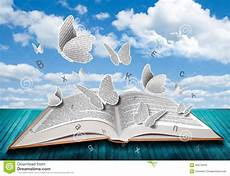 libro lettere d open book with butterflies letters on blue sky stock