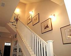 custom railing and lighting sconces highlight the stairwells that provide access to the second