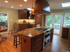 wooden kitchen island with modern stove top on glossy
