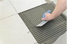 laying ceramic tiles stock photo image of concrete