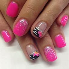 hot pink gel nails with fading glitters and zebra design