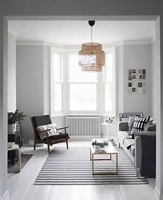 white walls and in floor storage make this creative house design interior trend soft pink walls living room white grey