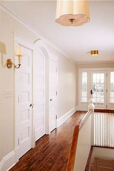 benjamin manchester is a light beige paint colour shown in hallway with tons of