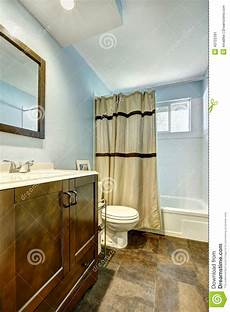 bathroom with brown tile floor and light blue walls stock image image of indoor curtain 43722391