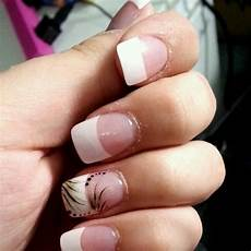 french nails with a design on the ring finger french