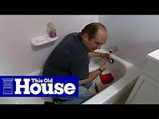 how to clear a clogged bathtub drain this house