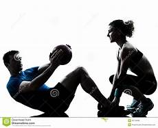fitness male and female man woman exercising weights workout fitness ball royalty