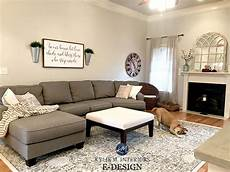 sherwin williams agreeable gray in living room with gray sectional area rug fireplace
