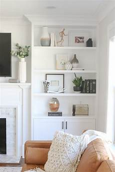 the dos and don ts of decorating built in shelves the
