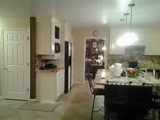 should i paint the trim in my kitchen the same color as the walls