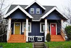 navy blue house colour with bright yellow or orange door rebuild exterior in 2019 bright navy exterior of a home in portland or photo