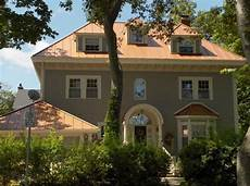 i like the copper roof with this color siding then colonial would great lower half