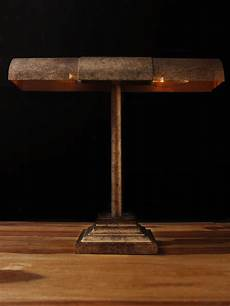warm industrial style shines in a st petersburg industrial style bankers table l in a distressed aged