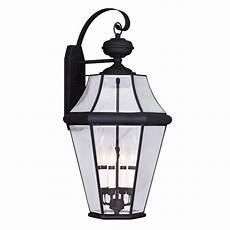 livex lighting 4 light black outdoor wall lantern with clear beveled glass 2366 04 the home depot