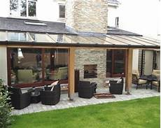 cozy house backyard extension design ideas inspiring pergola with transparent roofing for cozy