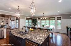 house plans with large kitchen island this island kitchen and dining room flow in this open