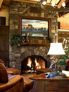 great stone fireplace with built in large screen above the mantle favorite homes home