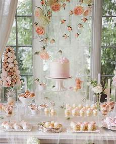 peach and blush wedding dessert table with macarons and rose backdrop beautiful pink and