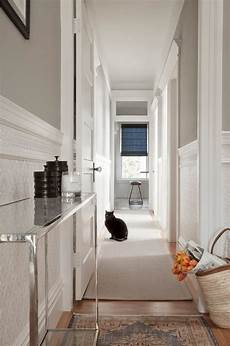 and narrow hallway with slim console table