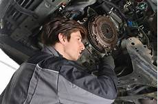 auto mechanic working the car and changing clutch
