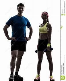 fitness male and female woman exercising fitness workout with man coach posing