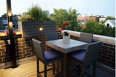 rooftop deck with landscape lighting bbq and outdoor heater lakeview chicago urban