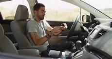 In Car - hispanic sitting in car stock footage 100