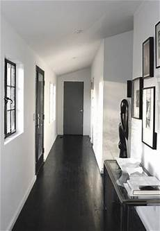 white walls and in floor storage make this creative house design black floor boards painted with 2 coats of water based